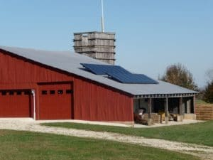 The solar panels on the roof of the Belshe farm in Cuba, Mo. produce clean, renewable electricity at a reasonable cost.