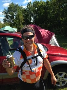 Drinking a well-deserved beer after 75 miles on the  bike