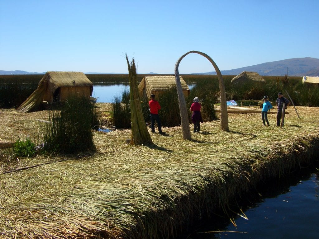 One of many of the floating Uros Islands, with an arch woven of the same reeds used to make the island.