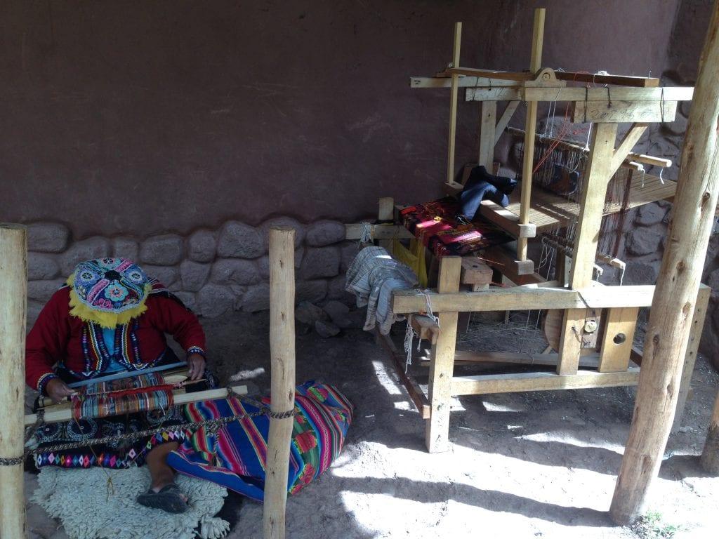 Native Peruvian women weaving their hand-spun alpaca wool into beautiful linens, blankets and clothing